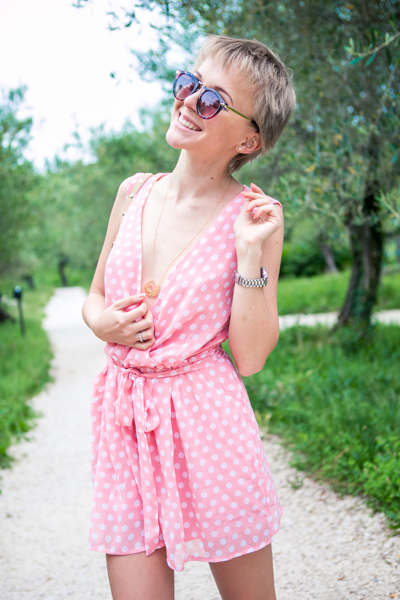 thecablook darya kamalova fashion blog street style sirmione italy verona jumpsuit rompers polka dots pixie cut short hair zanotti sandals rebecca minkoff bag vj style sunnies sunglasses outfit-134