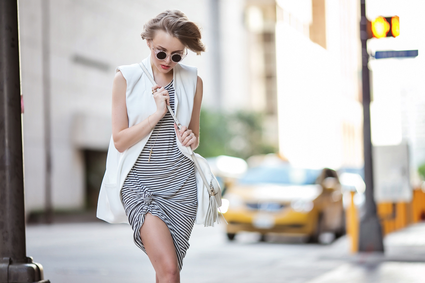 darya kamalova a fashion blogger from thecablook is wearing zara striped long dress with white sleeveless jacket and gucci disco soho bag in white leather-11