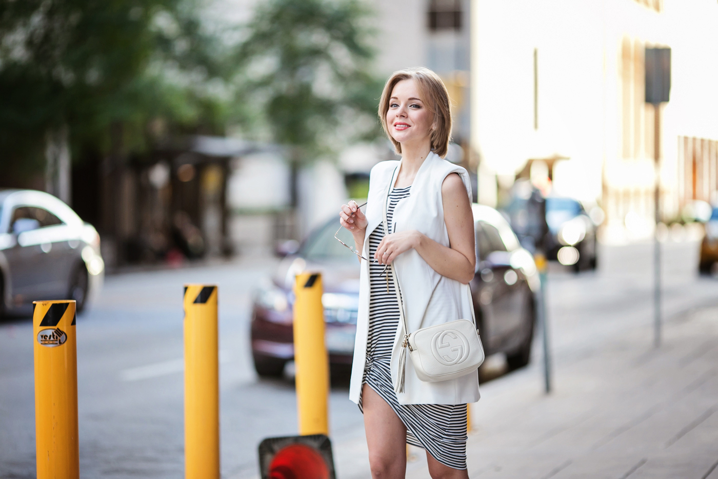 darya kamalova a fashion blogger from thecablook is wearing zara striped long dress with white sleeveless jacket and gucci disco soho bag in white leather-33