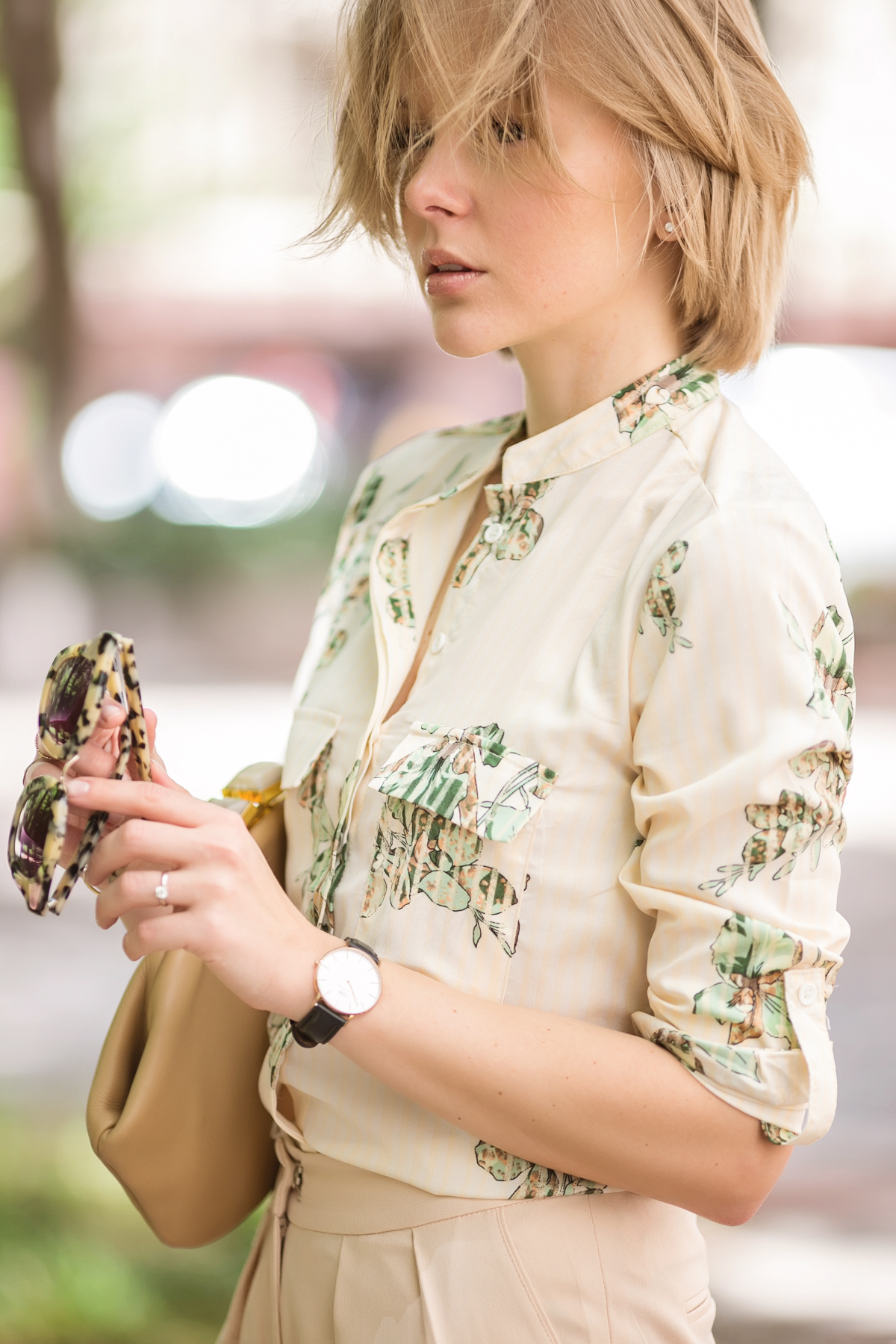 darya kamalova from thecablook in dallas texas is wearing beige pants and beige shirt with green leaves with marni retro ctutch and asos handmade sunglasses-23