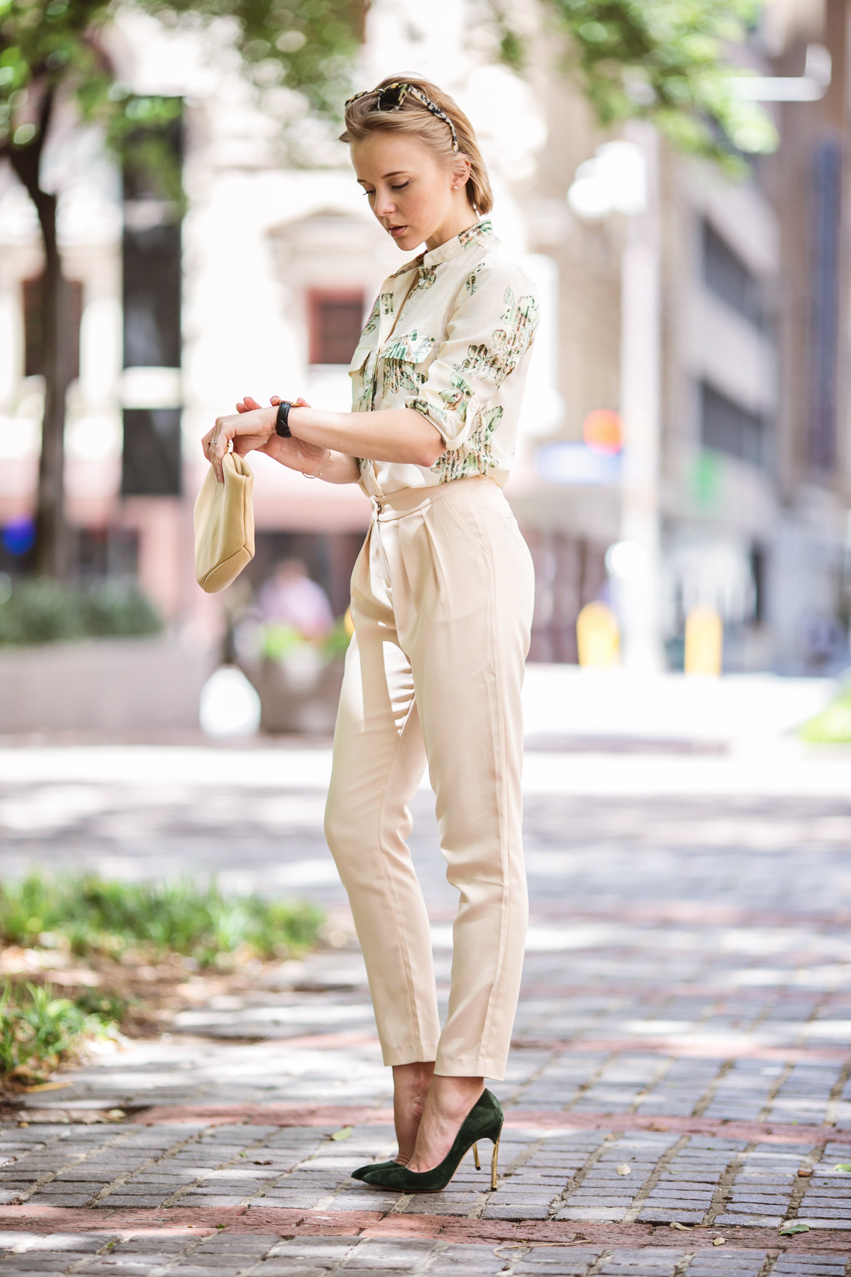 darya kamalova from thecablook in dallas texas is wearing beige pants and beige shirt with green leaves with marni retro ctutch and asos handmade sunglasses-33