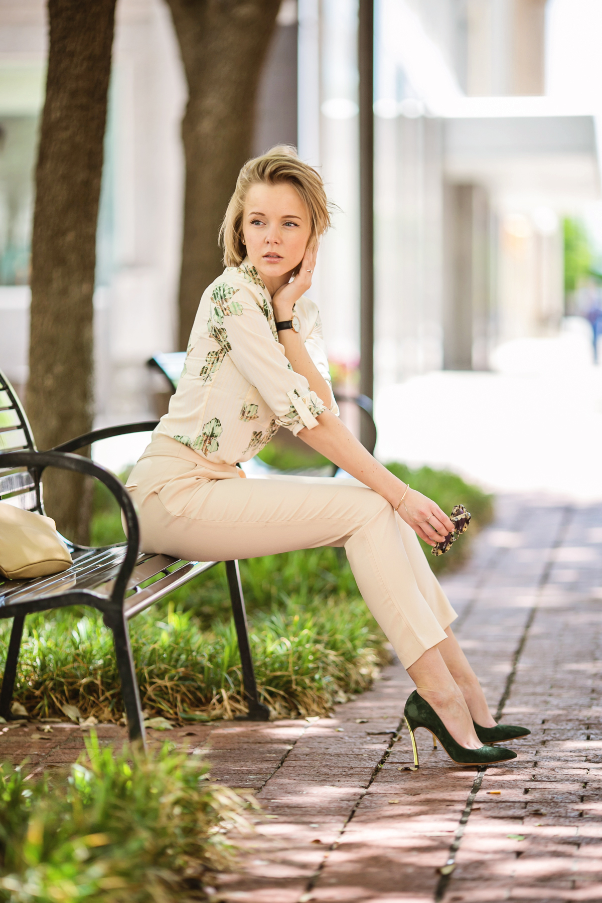 darya kamalova from thecablook in dallas texas is wearing beige pants and beige shirt with green leaves with marni retro ctutch and asos handmade sunglasses-42