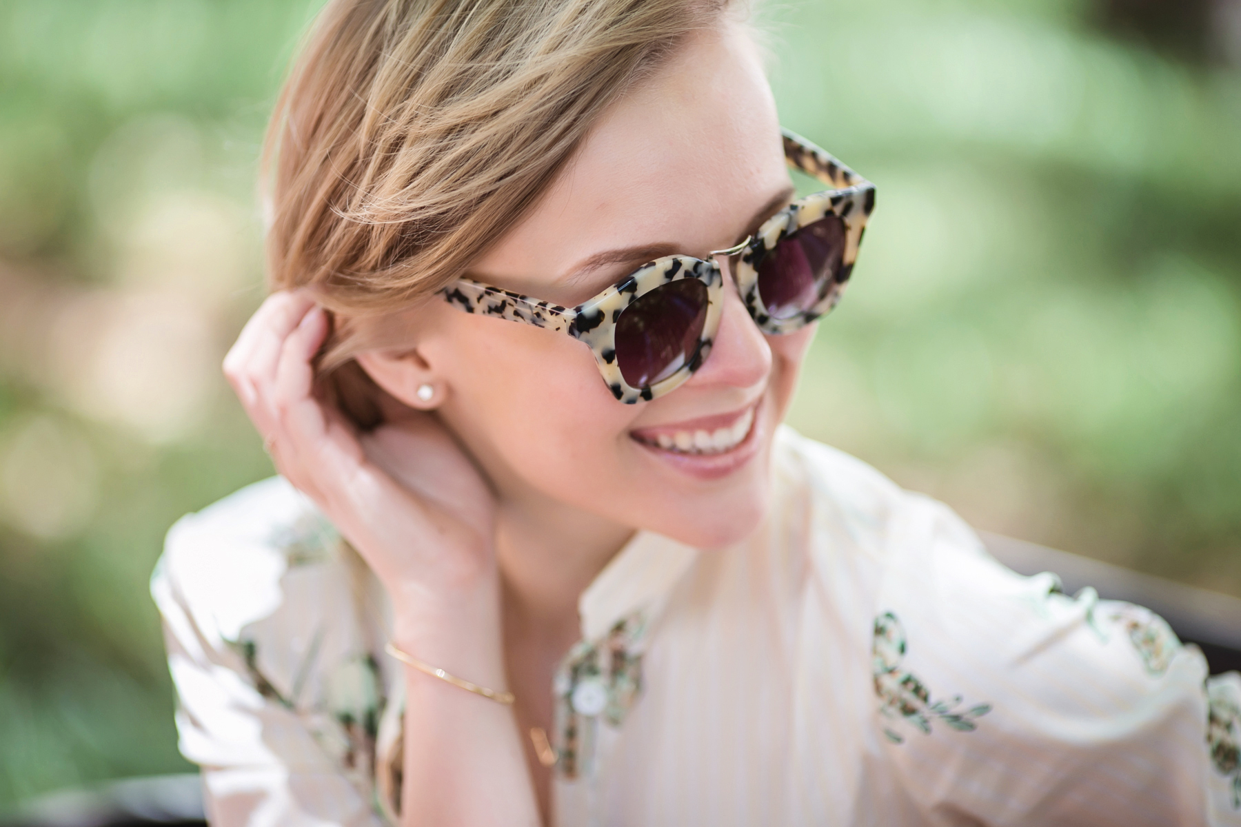 darya kamalova from thecablook in dallas texas is wearing beige pants and beige shirt with green leaves with marni retro ctutch and asos handmade sunglasses-52